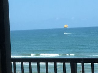 Oceanfront stunning view from top floor. Perfect vacation just steps from surf!