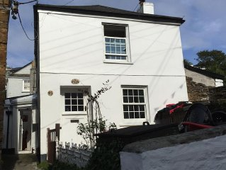 Detached character cottage in heart of old Polruan with sun terrace with view