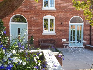 A delightful mews cottage within the private grounds of Breedon Hall