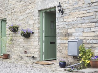 1 Withy Cottages has 2 bedrooms a cosy sitting room with wood burning stove.