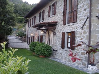 In exclusive resort and reserved old Tuscan farmhouse in stone and wood