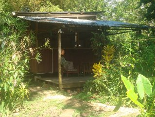 Caribbeanstyle wooden house in lush garden,150m from the beach
