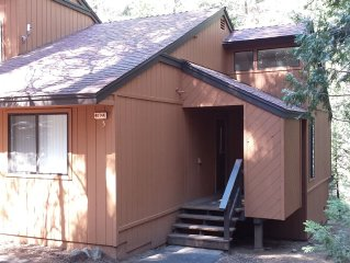 Cute & Woodsy 1 BR + Loft sleeps 4-6. Cable, WiFi, movies, games, pets welcome.