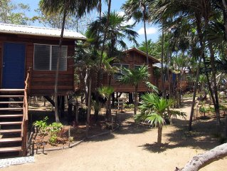 Bamboo Bungalow On The Beach At Leaning Palm Resort, With Wild Canes Bar & Grill