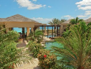 Award-winning beach villa with 2 pools, all master suites. Chef. Great value.