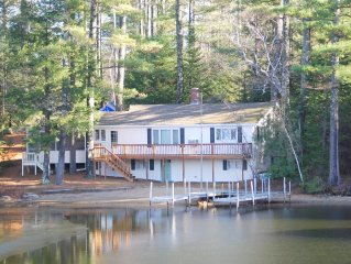 Waterfront home with private sandy beach & large U dock.