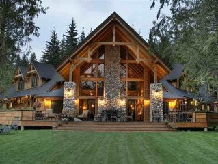 NEW Luxury Estate on Priest Lake Golf Resort with expansive views and fish pond.