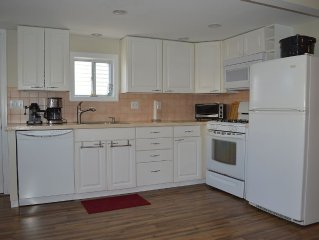 JUNE SPECIAL!! - 2 BR First Floor Beach House Steps To the Beach and Downtown!