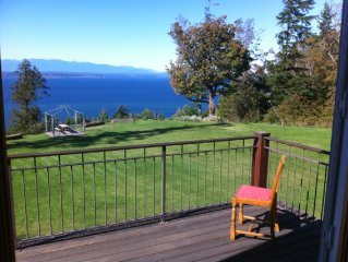 12 acres; waterfront; home perched on bluff; 15 min to Langley.