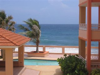 Tropical Paradise! Ocean Front Condo with the beach just steps from your door!