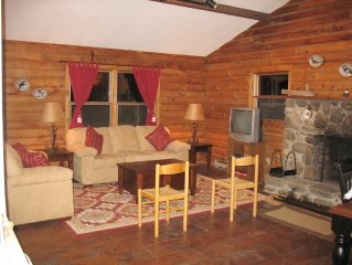 Log cabin ambience with today's conveniences overlooks 400 private acres, views