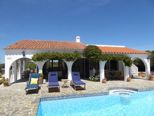 Secluded villa with private pool, 360 views, gardens near safe sandy beach.