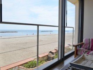 Maison sur la plage face à la mer