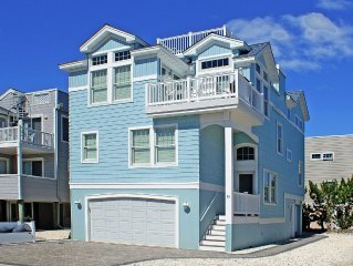 Gorgeous oceanside 4 bedroom, 3 1/2 bath custom-built home steps from the beach