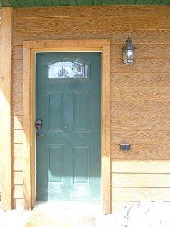 Door to far left garage doors in building on right
