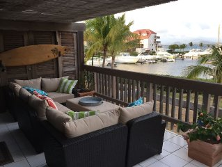 Peaceful Waterfront Corner Condo, Just Steps To The Beach