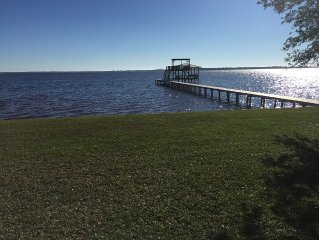 Quaint waterfront cottage on Perdido Bay with pier and a fantastic view