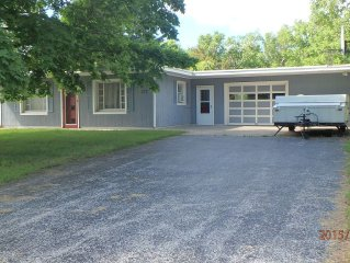 Cozy cottage minutes from Lake Michigan, pristine beaches, canoeing, fishing.