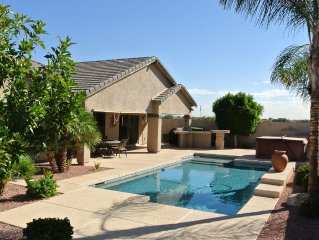Open Concept w/view of AMAZING patio, pool area, hot tub, gas fire pit & grill!!