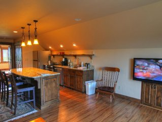 Great room with wood floors & granite counters