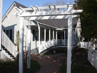 Walk to Downtown New Bern from this lovely,  private gardenside cottage.