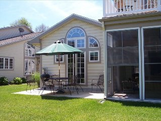 Patio w/Grill & Screened Sunroom. Deck above Sunroom - outside of 2nd M/Bedroom