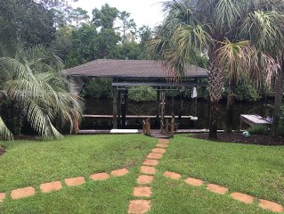 4BR/4B  Canal home, boat slip, outside entertainment area & walk to beach