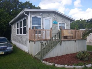 Come enjoy this cozy corner mobile home-  only miles away from Beaches!