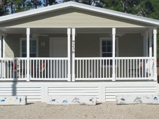 Walk to the beach or enjoy the spacious front porch....