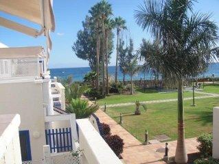 Bahia Feliz Apartamento  primera línea al mar con vistas 20m playa ,jardines .