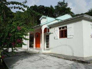 Villa familiale avec jardin creole, riviere et foret tropicale a Pointe Noire