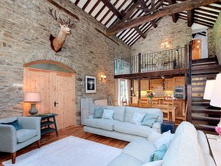 A beautiful 17th century stone barn conversion set within two acres of grounds