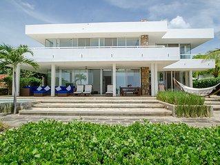 Modern 4 bedroom on-the-sand beach house right on the surf break! (sleeps 8)