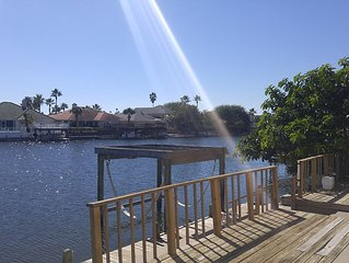 Bottom Level Canal Water Front Home with Boat Dock & Extra Parking!
