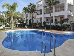 Fantastic Apartment with Pool and Stunning Views Across Golf Course and Mountain
