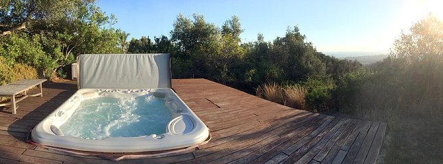 The jacuzzi is larger that it looks - it accommodates 8 people.
