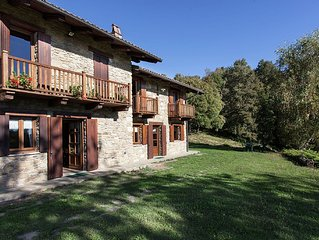 Apartment in old renovated farmhouse, with garden, surrounded by greenery.