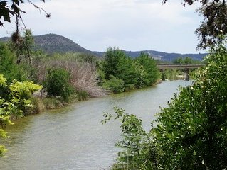 Riverfront property under giant Live Oaks on a bluff overlooking Sabinal River