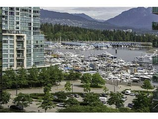 Fully furnished Spacious suite with water and mountain views in Coal Harbour