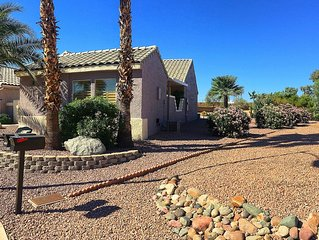 Front and side view of Casita with view onto golf course