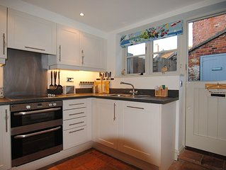 Well-equipped kitchen with cooker, fridge freezer and microwave