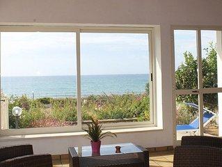 Villa Sara, an air-conditioned veranda overlooking the sea.