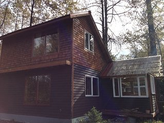 Eagle's Nest Cabin on Salmon Creek and private, large wooded lot.