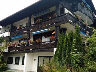 Familienwohnung mit 3 Schlafzimmern, Terrasse, eigenem Garten und Bergblick