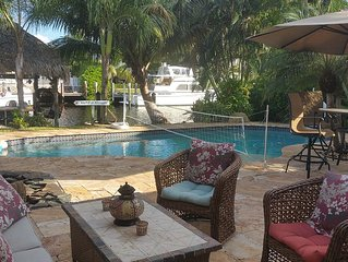 Beautiful Waterfront Intracoastal Home, heated pool, dock, jacuzzi, Tiki