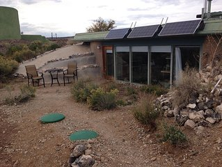 Come stay in our Taos Earthship studio and experience sustainable living!