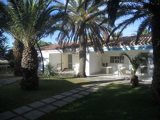 Holiday villa with lagoon, dune views, sleeps 8, large private garden.