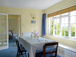 Charming cottage, set in a large garden within a Devon village with lovely views