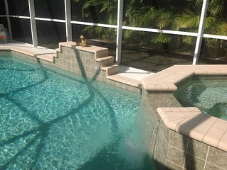 It's Tiki Time! Enjoy VERY PRIVATE heated pool w/spa, walk or bike to beaches!