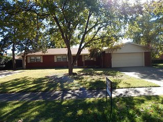 Wonderful 4/3/2 with 2 Masters, 2 Driveways & 2 Living Areas in Central Lubbock